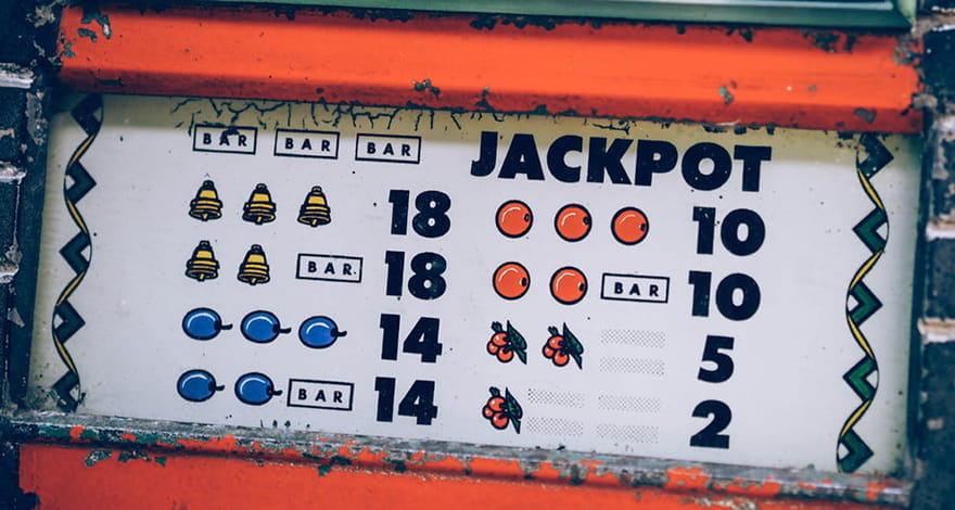 An Old Jackpot Fruit Machine Printed on a Wall