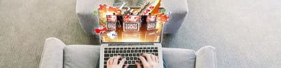 A Laptop that depicts Fruit Machines on its Screen and Many Chips Are Falling from the Sky